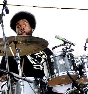 Questlove, whose recent Folk Alliance appearance failed to convince even the most gullible attendees, is now working as the house musician on Jimmy Fallon Live.