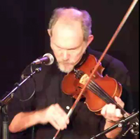 The fiddler Bruce Molsky, shown here in his own body, had a devil's goatee, hands like cloven hooves, and a generally demonic intensity when he played.
